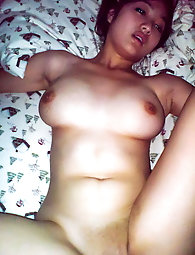 Asian female is posing fully undressed